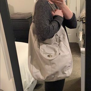 Beige Express hobo bag, great for traveling!
